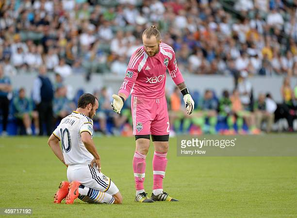 Stefan Frei of Seattle Sounders FC offers a hand to Landon Donovan of Los Angeles Galaxy after a collision during a 21 Galaxy win in the Western...