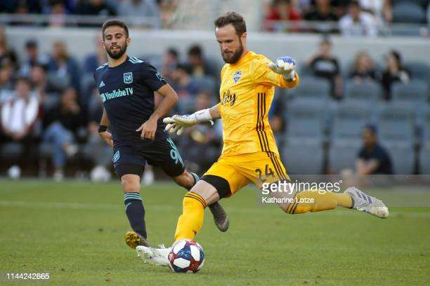 Stefan Frei of Seattle Sounders kicks the ball out while Diego Rossi of Los Angeles FC moves in during the second half of a game at Banc of...