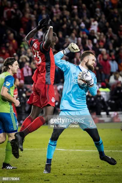 Stefan Frei of Seattle Sounders tries break away from Chris Mavinga of Toronto FC during the 2017 Audi MLS Championship Cup match between Toronto FC...