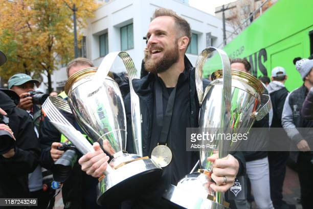 Stefan Frei of the Seattle Sounders holds his MLS Cup trophies from 2016 and 2019 during their MLS Cup victory parade on November 12 2019 in Seattle...