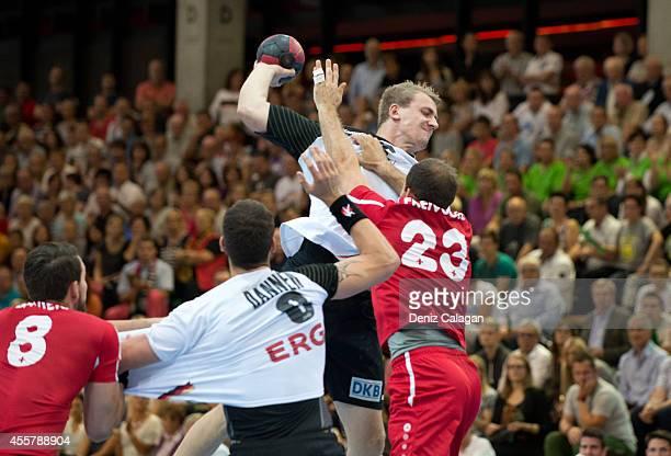 Stefan Freivogel of Switzerland challenges Julis Kuen of Germany during the international friendly match between Germany and Switzerland on September...