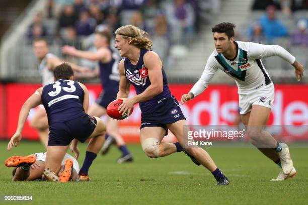 Stefan Giro of the Dockers looks to pass the ball during the round 17 AFL match between the Fremantle Dockers and the Port Adelaide Power at Optus...