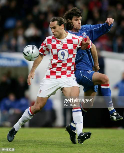 Stefan Gislason of Iceland struggles with Dado Prso of Croatia and concedes a penalty during the 2006 World Cup qualifying match between Iceland and...