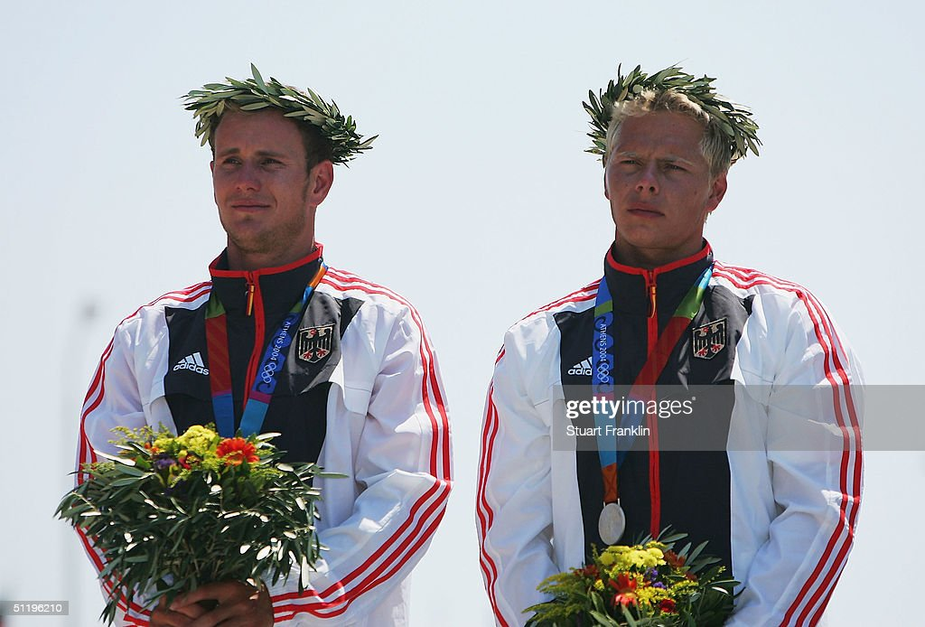 Stefan Henze and Markus Becker of Germany receive their silver medals during ceremonies for the men's C-2 class slalom event on August 20, 2004 during the Athens 2004 Summer Olympic Games at the Schinias Olympic Slalom Centre in Athens, Greece.