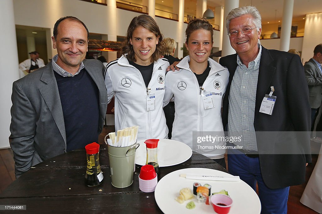 Stefan Herth of Infront, Annike Krahn, Melanie Leupolz and Gerd Hoffmann of Daimler are seen during the DFB Team & Sponsors Cooking Event on June 24, 2013 in Munich, Germany.