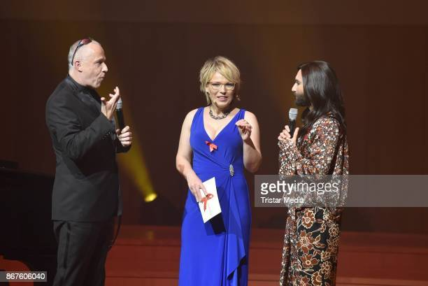Stefan Hippler Andrea Ballschuh and Conchita Wurst attend the 12th Hope Charity Gala at Kulturpalast on October 28 2017 in Dresden Germany