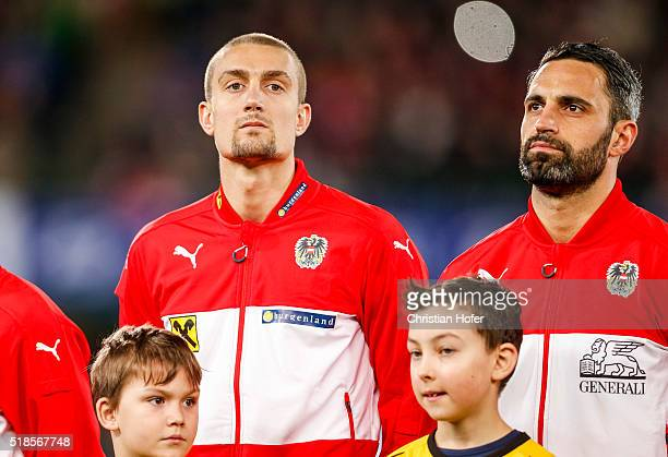 Stefan Ilsanker and goalkeeper Ramazan Oezcan of Austria line up during the national anthem prior to the international friendly match between Austria...
