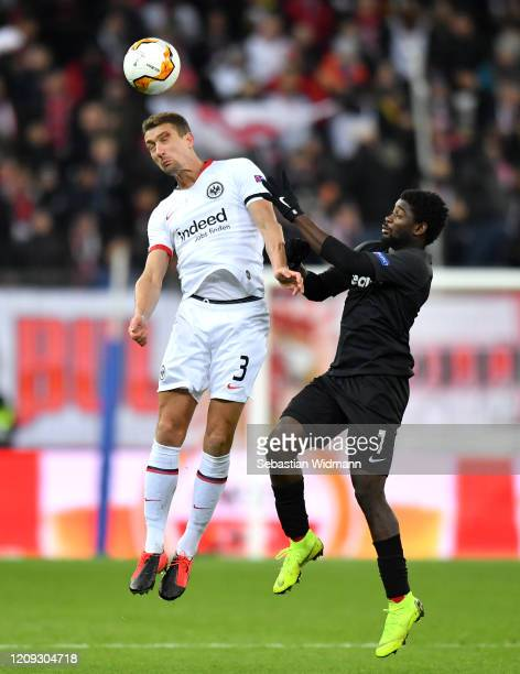Stefan Ilsanker of Frankfurt and Sekou Koita of Salzburg battle for possession during the UEFA Europa League round of 32 second leg match between RB...