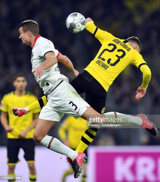 Stefan Ilsanker of Frankfurt jumps for a header with Thorgan Hazard of Dortmund during the Bundesliga match between Borussia Dortmund and Eintracht...