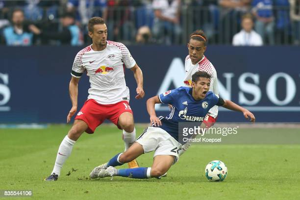 Stefan Ilsanker of Leipzig Amine Harit of Schalke and Yussuf Poulsen of Leipzig during the Bundesliga match between FC Schalke 04 and RB Leipzig at...
