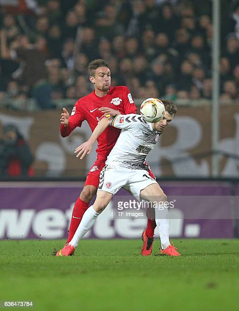 Stefan Ilsanker of RB Leipzig and Christopher Buchtmann of St Pauli battle for the ball during the Second Bundesliga match between FC St Pauli and...