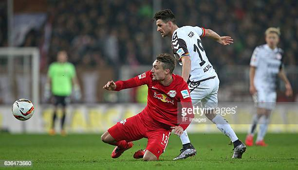 Stefan Ilsanker of RB Leipzig and Enis Alushi of St Pauli battle for the ball during the Second Bundesliga match between FC St Pauli and...