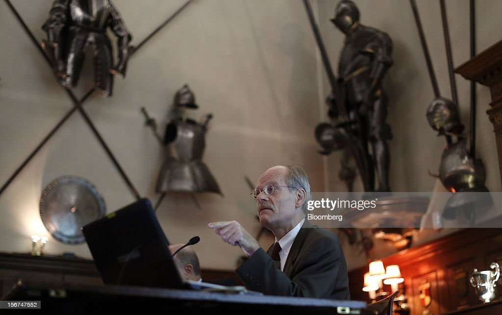 Stefan Ingves, governor of Sweden's central bank, gestures toward his laptop computer during an event hosted by the Official Monetary and Financial Institutions Forum (OMFIF) in London, U.K., on Tuesday, Nov. 20, 2012. Sweden's economy is stagnating as a recession in the euro area saps export demand, prompting companies such as Ericsson AB to cut jobs. Photographer: Simon Dawson/Bloomberg via Getty Images