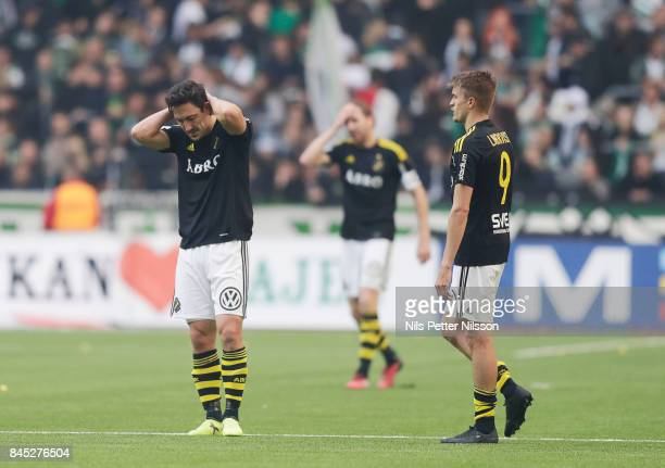 Stefan Ishizaki NilsEric Johansson and Rasmus Lindkvist of AIK dejected after the Allsvenskan match between Hammarby IF and AIK at Tele2 Arena on...