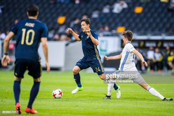 Stefan Ishizaki of AIK in a duel with Jakup Andreasen of KI Klaksvik during a UEFA Europe League qualification match at Friends arena on July 6 2017...