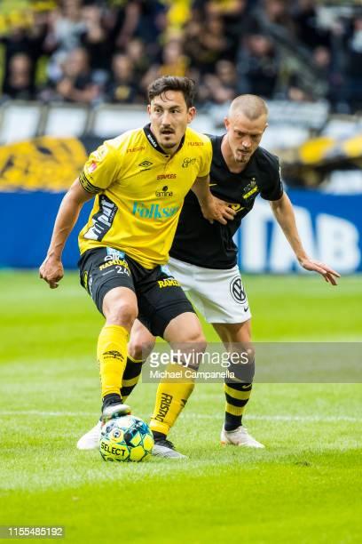 Stefan Ishizaki of IF Elfsborg protects the ball from Rasmus Lindkvist of AIK during an Allsvenskan match between AIK and IF Elfsborg at Friends...