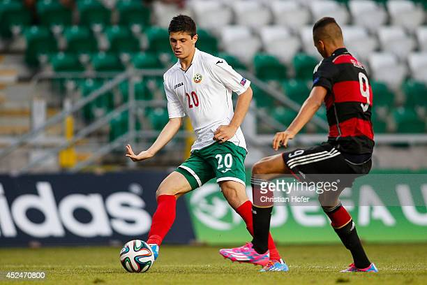 Stefan Ivov Velkov of Bulgaria competes for the ball with Davie Selke of Germany during the UEFA Under19 European Championship match between U19...