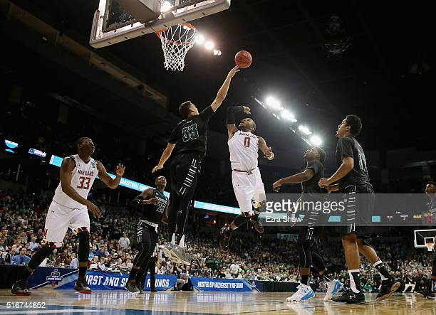 Stefan Jankovic of the Hawaii Warriors defends the net against Rasheed Sulaimon of the Maryland Terrapins in the second half during the second round...