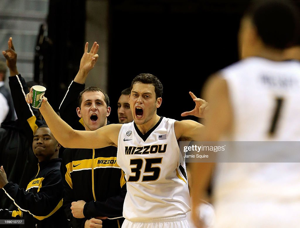 Stefan Jankovic #35 of the Missouri Tigers reacts from the bench alnogside teammates after Phil Pressey #1 made a three-pointer during the game against the Bucknell Bison at Mizzou Arena on January 5, 2013 in Columbia, Missouri.