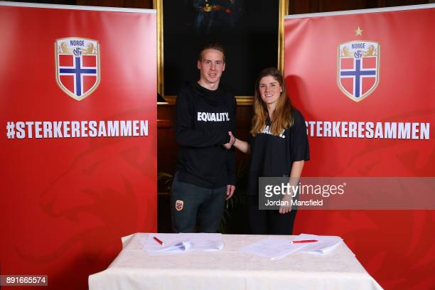 Stefan Johansen and Maren Mjelde shake hands during the Football Association of Norway National Team Equal Pay Agreement Announcement at the...