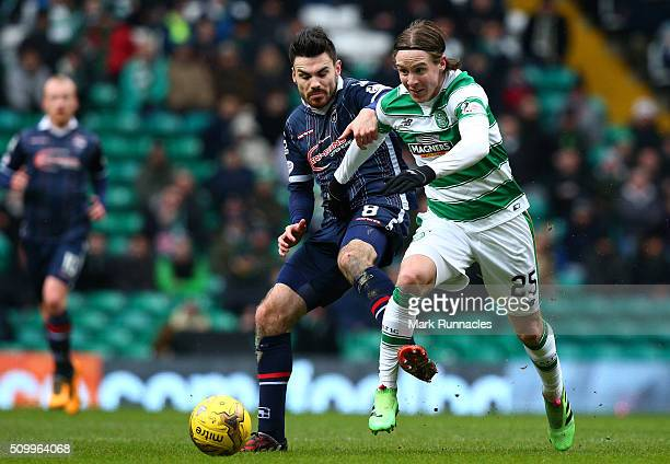 Stefan Johansen of Celtic is tackled by Ian McShane of Ross County during the Ladbrokes Scottish Premiership match between Celtic and Ross County at...