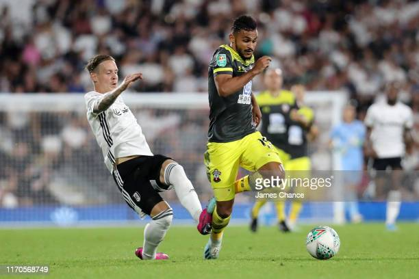 Stefan Johansen of Fulham challenges Sofiane Boufal of Southampton during the Carabao Cup Second Round match between Fulham and Southampton at Craven...