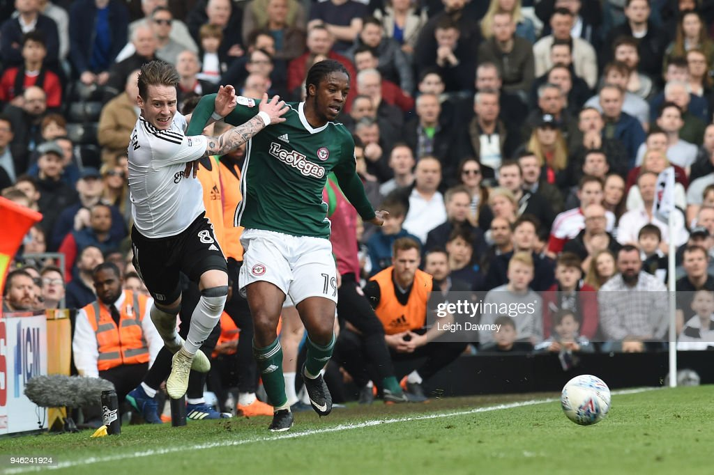 Stefan Johansen of Fulham clashes with Romaine Sawyers of Brentford during the Sky Bet Championship match between Fulham and Brentford at Craven Cottage on April 14, 2018 in London, England.