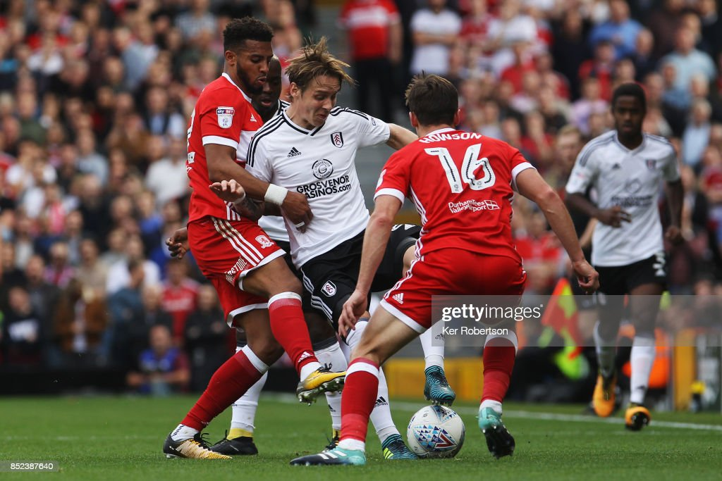 Stefan Johansen (C) of Fulham holds off the challenge of Cyrus Christie (L) and Jonny Howson (R) of Middlesbrough during the Sky Bet Championship match between Fulham and Middlesbrough at Craven Cottage on September 23, 2017 in London, England.