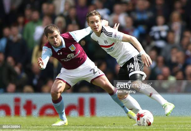 Stefan Johansen of Fulham is closed down by Gary Gardner of Aston Villa during the Sky Bet Championship match between Fulham and Aston Villa at...