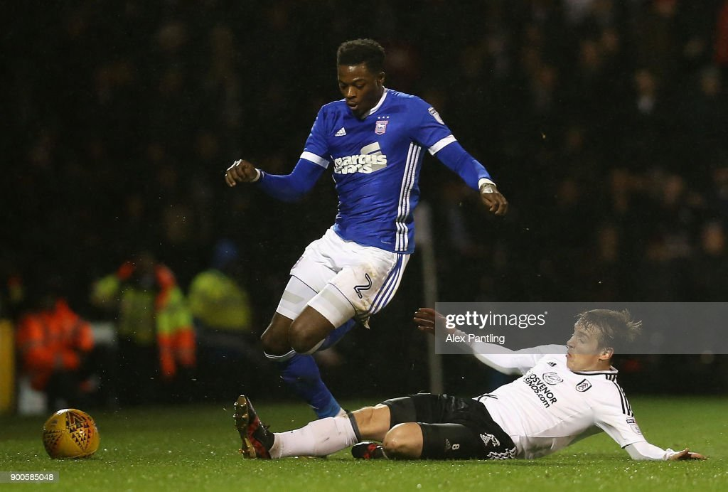 Stefan Johansen of Fulham tackles Dominic Iorfa of Ipswich during the Sky Bet Championship match between Fulham and Ipswich Town at Craven Cottage on January 2, 2018 in London, England.