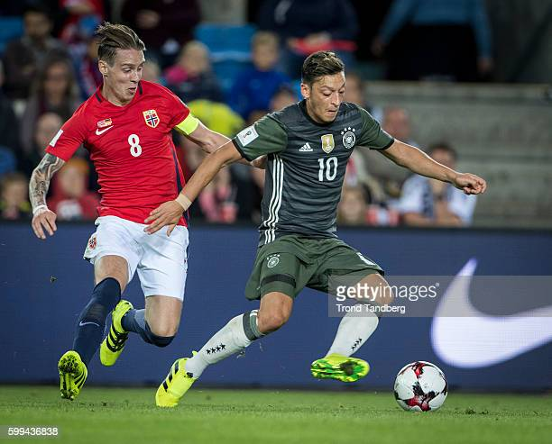 Stefan Johansen of Norway Mesut Ozil of Germany during 2018 FIFA World Cup Qualifier Norway v Germany at Ullevaal Stadion on September 4 2016 in Oslo...