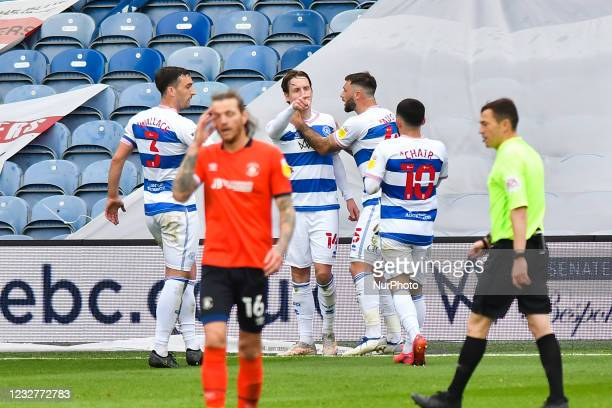 Stefan Johansen of QPR celebrates after scoring his team's second goal with his team mates during the Sky Bet Championship match between Queens Park...