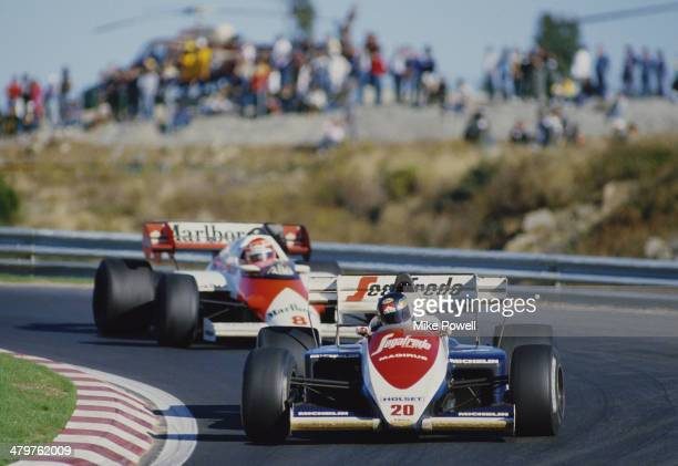 Stefan Johansson of Sweden drives the Toleman Group Motorsport Toleman TG184 Hart Straight-4 turbo ahead of Niki Lauda during the Portuguese Grand...