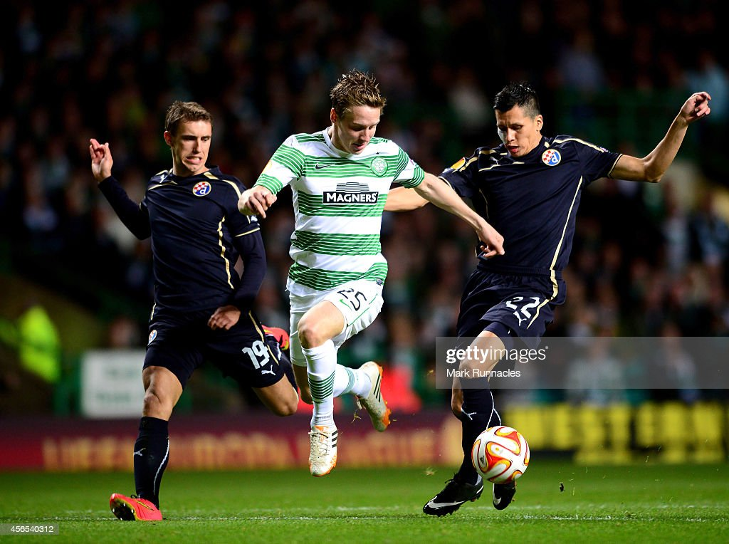 Stefan Johnansen of Celtic takes on Josip Pivaric and Leonardo Sigali of Dinamo Zagreb during the UEFA Europa League group D match between Celtic and Dinamo Zagreb at Celtic Park on October 02, 2014 in Glasgow Scotland.