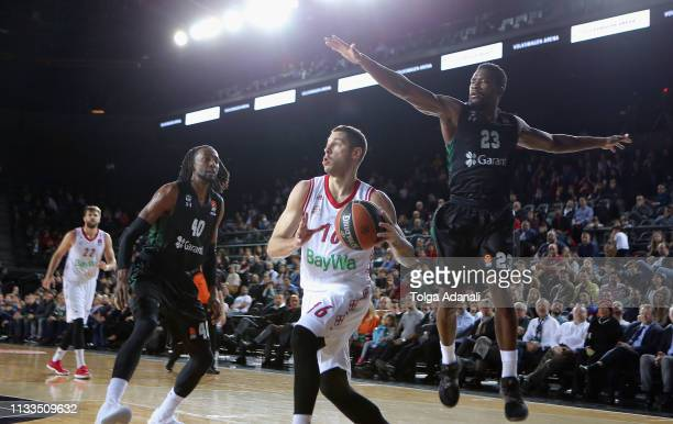 Stefan Jovic #16 of FC Bayern Munich in action with Toney Douglas #23 of Darussafaka Tekfen Istanbul during the 2018/2019 Turkish Airlines EuroLeague...