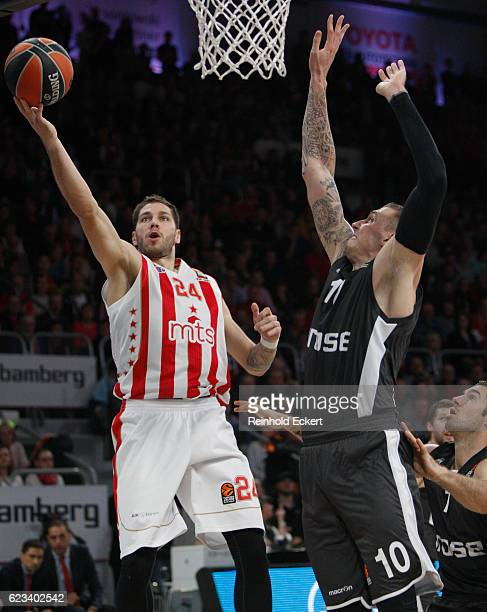 Stefan Jovic #24 of Crvena Zvezda mts Belgrade competes with Daniel Theis #10 of Brose Bamberg in action during the 2016/2017 Turkish Airlines...