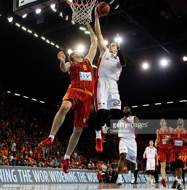 Stefan Jovic #24 of Crvena Zvezda Telekom Belgrade competes with Vladimir Micov #5 of Galatasaray Liv Hospital Istanbul during the Turkish Airlines...