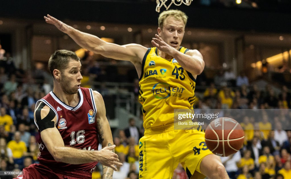 Stefan Jovic of Bayern Muenchen competes with Luke Sikma of ALBA Berlin during the fourth play-off game of the German Basketball Bundesliga finals at Mercedes-Benz Arena on June 13, 2018 in Berlin, Germany.