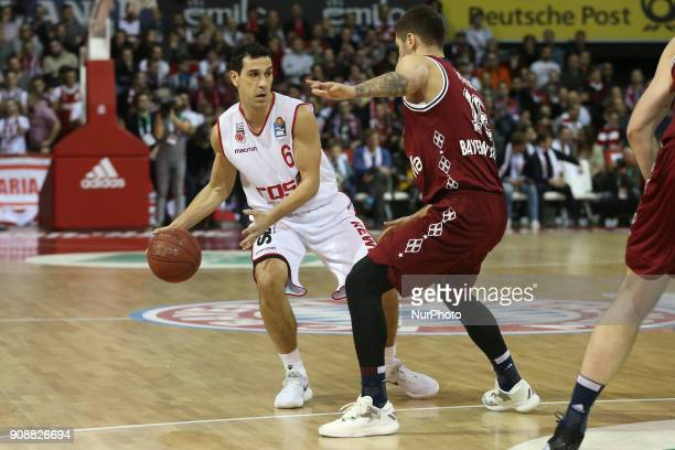 Stefan Jovic of Bayern Muenchen vies Nikolaos Zisis of Brose Baskets Bamberg during the Quarterfinal match in the BBL Pokal 2017/18 between FC Bayern...