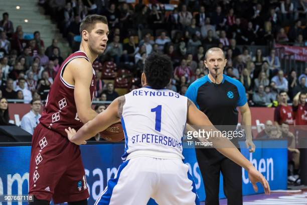 Stefan Jovic of Muenchen and Scottie Reynolds of St Petersburg battle for the ball during the EuroCup Top 16 Round 3 match between FC Bayern Munich...