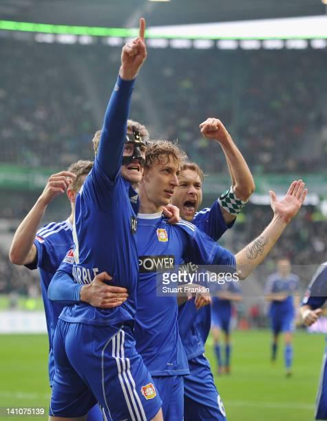 Stefan Kieflling of Leverkusen celebrates scoring his goal with Andre Schürrle during the Bundesliga match between VfL Wolfsburg and Bayer 04...
