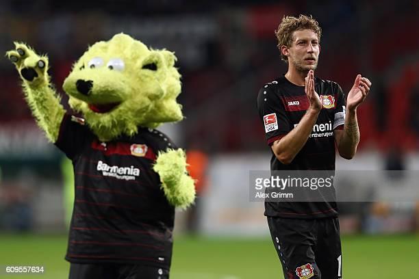 Stefan Kiessling and mascot 'Brian the Lion' react after the Bundesliga match between Bayer 04 Leverkusen and FC Augsburg at BayArena on September 21...