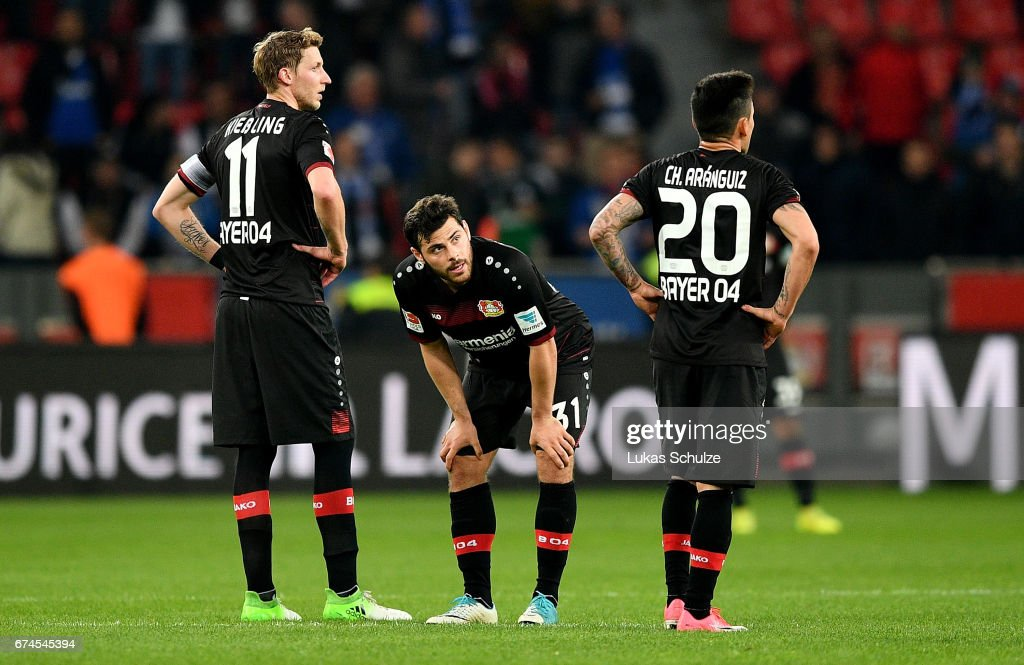 Stefan Kiessling, Kevin Volland and Charles Aranguiz of Leverkusen look dejected after the Bundesliga match between Bayer 04 Leverkusen and FC Schalke 04 at BayArena on April 28, 2017 in Leverkusen, Germany.
