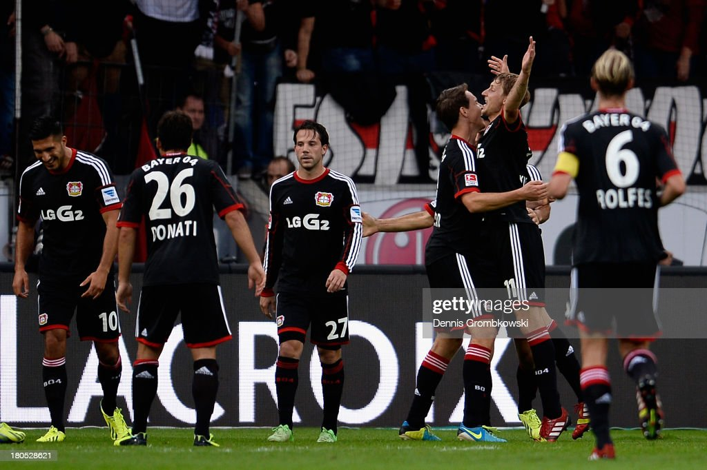 Stefan Kiessling of Bayer Leverkusen celebrates with teammates after scoring his team's third goal during the Bundesliga match between Bayer 04 Leverkusen and VfL Wolfsburg at BayArena on September 14, 2013 in Leverkusen, Germany.