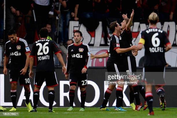 Stefan Kiessling of Bayer Leverkusen celebrates with teammates after scoring his team's third goal during the Bundesliga match between Bayer 04...