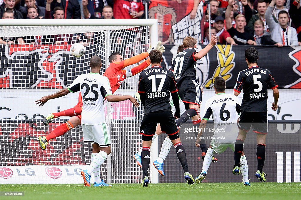 Stefan Kiessling of Bayer Leverkusen heads his team's second goal during the Bundesliga match between Bayer 04 Leverkusen and VfL Wolfsburg at BayArena on September 14, 2013 in Leverkusen, Germany.