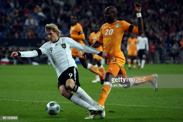 Stefan Kiessling of Germany is tackled by Guy Demel of Ivory Coast in the penalty box during the International Friendly match between Germany and...