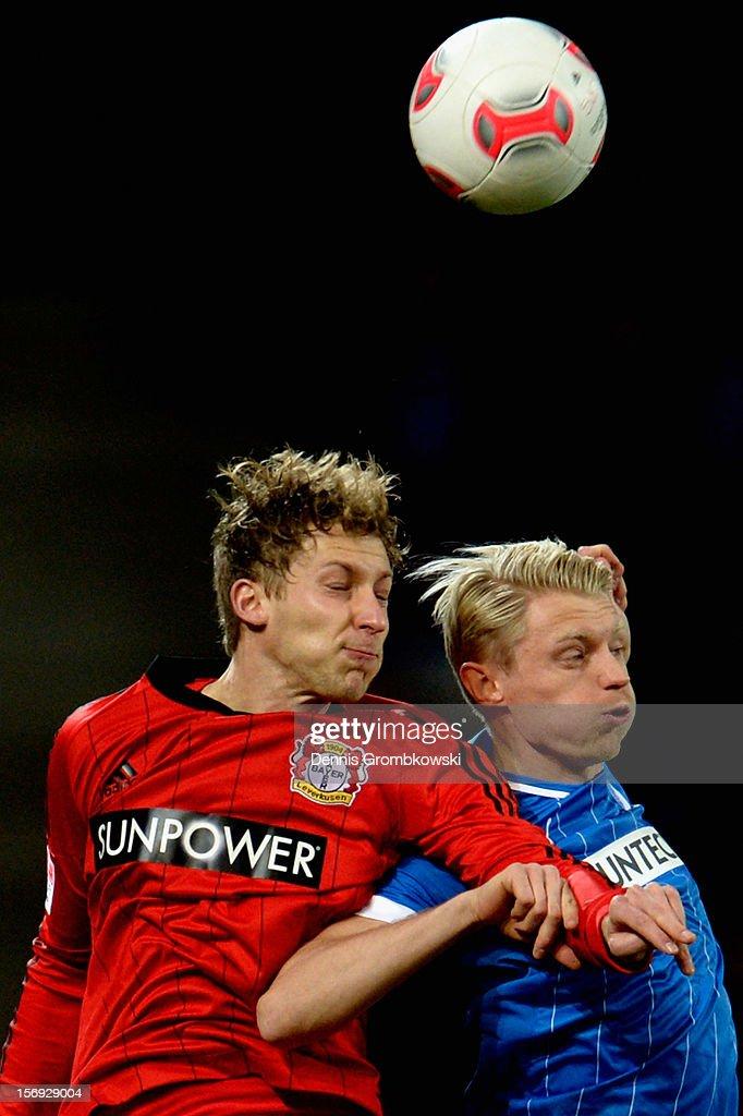 Stefan Kiessling of Leverkusen and Andreas Beck of Hoffenheim go up for a header during the Bundesliga match between TSG 1899 Hoffenheim and Bayer 04 Leverkusen at Rhein-Neckar-Arena on November 25, 2012 in Sinsheim, Germany.