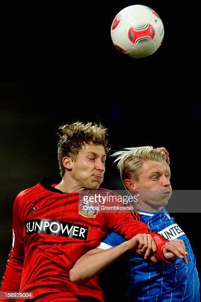 Stefan Kiessling of Leverkusen and Andreas Beck of Hoffenheim go up for a header during the Bundesliga match between TSG 1899 Hoffenheim and Bayer 04...