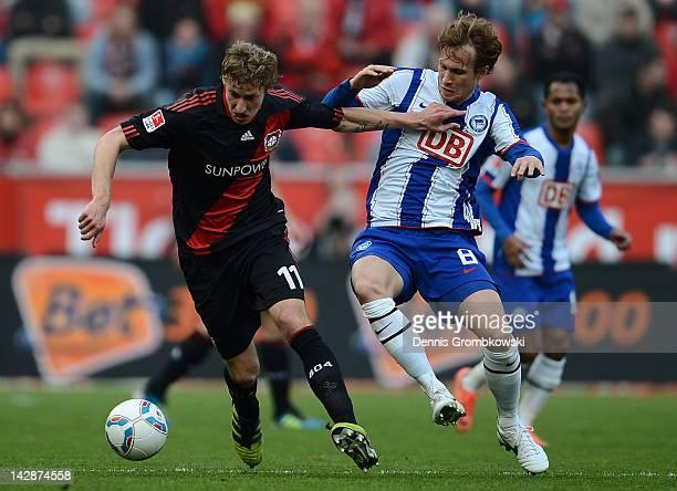 Stefan Kiessling of Leverkusen and Andreas Ottl of Berlin battle for the ball during the Bundesliga match between Bayer 04 Leverkusen and Hertha BSC...